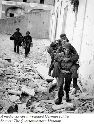 A picture of a medic carrying a wounded German soldier
